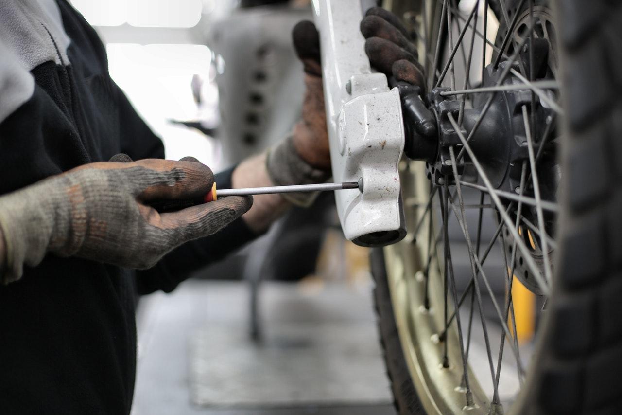 Experienced Mechanic Repairing Used Motorcycle | Imperial Motorcycles